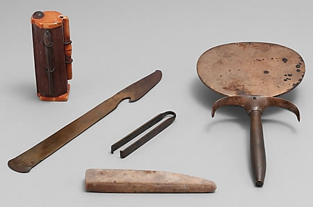 Cosmetic set of Ancient kohl tube with applicator and tweezers, razor, mirror and sharpening stone