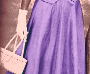 Vintage photo of woman with white gloves, white purse and long purple skirt