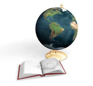 Image of a Bible and glasses in front of world globe