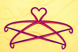 Image of two clothes hangers stacked to create a heart shape