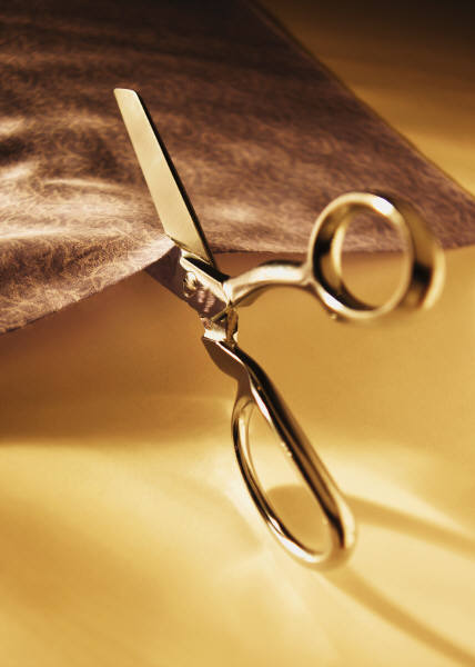 Scissors cutting fabric